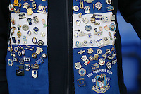 Detail shot showing a number of pin badges on the scarf of an Everton fan pictured in the stands at Goodison Park ahead of the Barclays Premier League match between Everton and Swansea City played at Goodison Park, Liverpool