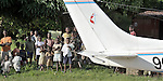 Villagers observe a Cessna P210 on the airstrip in Kamina in the Democratic Republic of the Congo. The plane is part of the Wings of the Morning aviation ministry of The United Methodist Church, providing life-saving access to isolated rural communities.