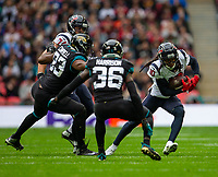 3rd November 2019; Wembley Stadium, London, England; National Football League, Houston Texans versus Jacksonville Jaguars; Wide Receiver DeAndre Hopkins of Houston Texans under pressure from Defensive Back Ronnie Harrison of Jacksonville Jaguars - Editorial Use