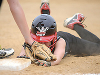 William Tennent's Kaite Clark slides back safely into first base as Council Rock North's Hannah Stalker applies the tag Monday May 18, 2015 at Council Rock North in Newtown, Pennsylvania. William Tennent defeated Council Rock North 4-0 in the first-round District One Class AAAA softball playoff game. (Photo by William Thomas Cain/Cain Images)