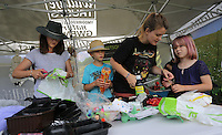 Pictured: Sarah Wygas (L) with son Henry (2nd L) and daughter Martha 6 (R) and Tamar Williams of Puppet Soup (3rd L) Saturday 13 August 2016<br />Re: Grow Wild event at  Furnace to Flowers site in Ebbw Vale, Wales, UK