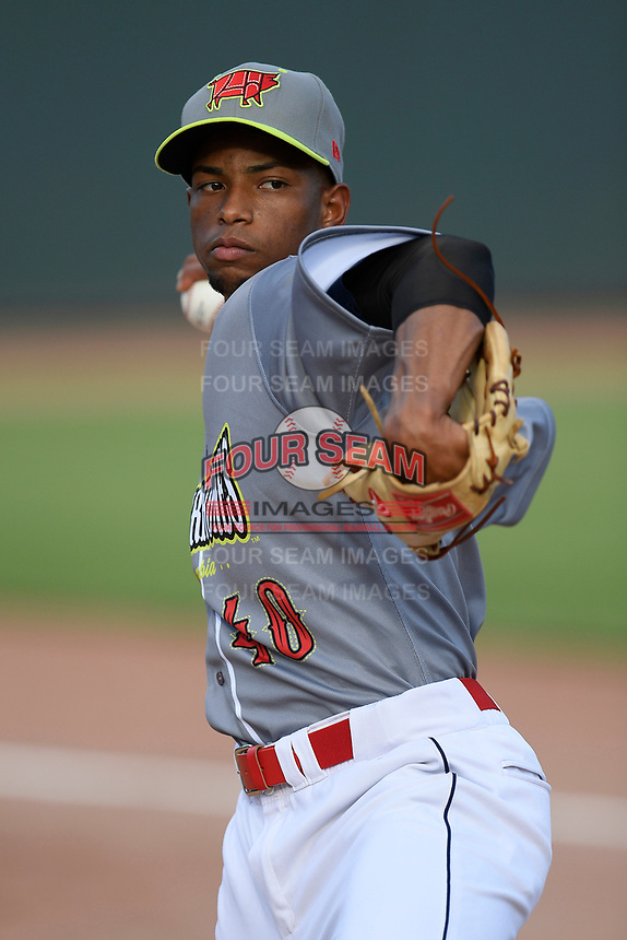 Starting pitcher Willy Taveras (40) of the Columbia Fireflies, playing as the Chicharrones de Columbia, warms up before a game against the Charleston RiverDogs on Friday, July 12, 2019 at Segra Park in Columbia, South Carolina. The RiverDogs won, 4-3, in 10 innings. (Tom Priddy/Four Seam Images)