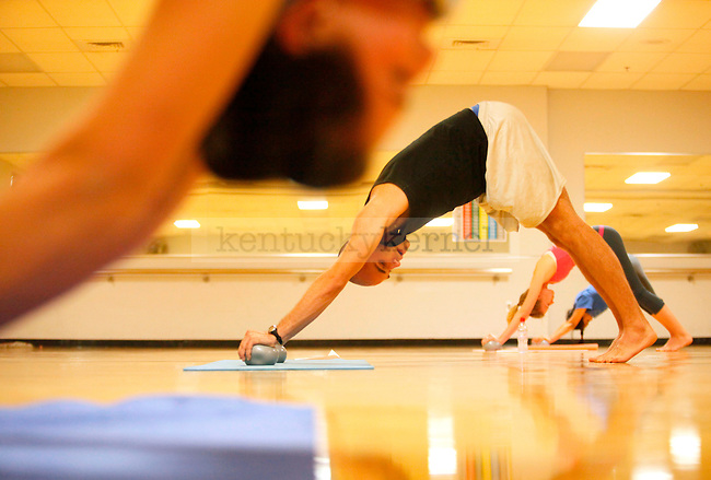 Kinesiology senior Patrick Sims leads exercises during the yoga class held at the Johnson Center on Monday. Photo by Zach Brake | Staff