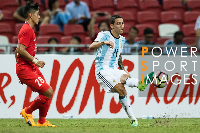Angel Di Maria of Argentina (R) in action during the International Test match between Argentina and Singapore at National Stadium on June 13, 2017 in Singapore. Photo by Marcio Rodrigo Machado / Power Sport Images