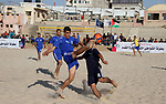 Palestinian players of Khadamat al-Shati club (blue) compete with players of al-Hilal club (Dark Blue) during the final football match of Beach Soccer Championship, in Gaza city on May 9, 2018. Photo by Mahmoud Ajour