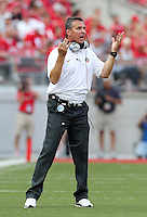 Ohio State Buckeyes head coach Urban Meyer motions to his offense from the sideline during the third quarter of the NCAA football game at Ohio Stadium in Columbus on Sept. 7, 2013. (Adam Cairns / The Columbus Dispatch)