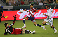 LA Galaxy goalkeeper Joe Cannon (1) defends his goal against Chivas forward Maykel Galindo (11). CD Chivas USA defeated the LA Galaxy 3-0 in the Super Classico MLS match at the Home Depot Center in Carson, California, Thursday, August 23, 2007.