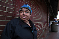 (171115RREI1303)  Maribel, one of the few women,  at La Esquina where Latinos have gathered for decades at the corner of Mt. Pleasant St. and Kenyon St. NW. to play chekers (damas). Washington DC.  Nov. 15 ,2017 . ©  Rick Reinhard  2017     email   rick@rickreinhard.com
