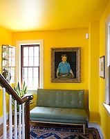 "Charles Hawthorne's ""Boy with Fish"" hangs above a vintage Paul McCobb settee on the landing"