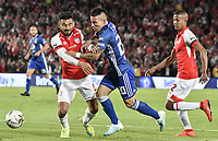 BOGOTA - COLOMBIA, 07-09-2019: Andres Perez del Santa Fe disputa el balón con Oscar Barreto de Millonarios durante partido entre Independiente Santa Fe y Millonarios por la fecha 10 de la Liga Águila II 2019 jugado en el estadio Nemesio Camacho El Campín de la ciudad de Bogotá. / Andres Perez of Santa Fe vies for the ball with Oscar Barreto of Millonarios during match between Independiente Santa Fe and Millonarios for the date 10 as part of the Aguila League II 2019 played at Nemesio Camacho El Campín stadium in Bogota city. Photo: VizzorImage / Gabriel Aponte / Staff