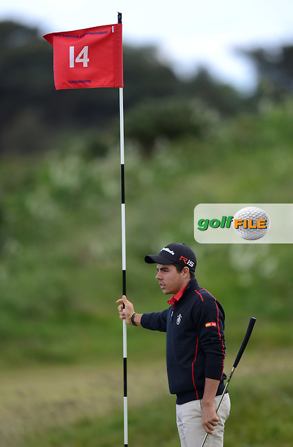 A Caddie stands with a flag stick during the First Round of the 120th Amateur Championship at Carnoustie Golf Links, Carnoustie, Scotland. Picture: Golffile | Richard Martin Roberts<br /> All photo usage must carry mandatory copyright credit (&copy; Golffile | Richard Martin Roberts)