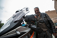 Photojournalist Pierre Alozie gets ready to ride to the next event in Islington. For Pierre Alozie's website please click here: http://www.magicmonkeys.net/<br />