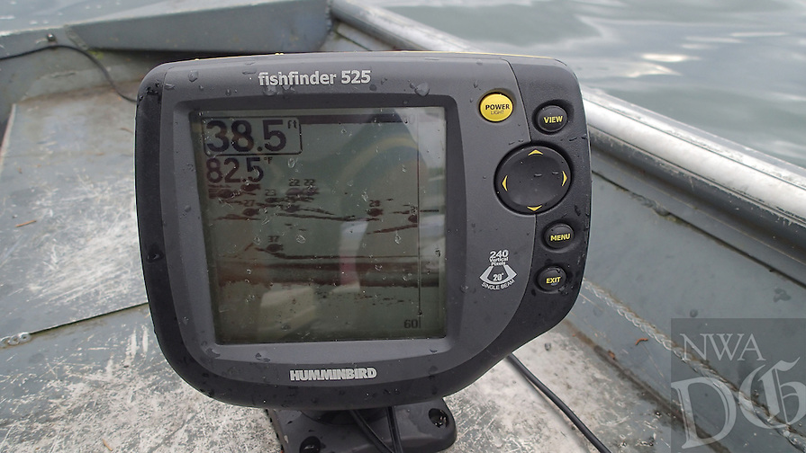 NWA Democrat-Gazette/FLIP PUTTHOFF <br /> A depth finder is key to catching fish with jigging spoons in summer and fall. The screen here shows schools of threadfin shad as well as game fish at various depths. Once fish are located, lower a jigging spoon over the side of the boat and let it hit bottom. Crank the reel a couple of turns and jig the spoon up and down with the rod tip. Raise it with a quick snap of the rod tip and let it sink on a tight line.