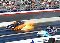Feb 8, 2015; Pomona, CA, USA; NHRA funny car driver Jeff Arend explodes a fuel tank causing a fire alongside Tommy Johnson Jr during the Winternationals at Auto Club Raceway at Pomona. Arend was uninjured in the explosion. Mandatory Credit: Mark J. Rebilas-