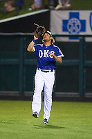 Oklahoma City Dodgers outfielder Kyle Jensen (22) catches a fly ball during a game against the Fresno Grizzles on June 1, 2015 at Chickasaw Bricktown Ballpark in Oklahoma City, Oklahoma.  Fresno defeated Oklahoma City 14-1.  (Mike Janes/Four Seam Images)