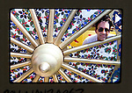 Ray Manzarek of the Doors posing in wheel of chariot at Hare Krishna Festival in Venice Beach in  Los Angeles.