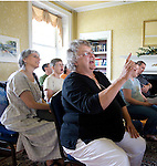 "Photo by Phil Grout..After the worship hour is finished, Polly Scott (front) of Laurel leads the Patapsco Friends Meeting in an impromptu singing of ""This Little Light of Mine""...join together in singing ""This Little Light of Mine"""