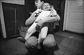 Niebiszczany, South-East Poland, November 2005<br /> The faces of Polish poverty<br /> Teresa Ogarek, age 39 and her son Sylwek,3. Sylwek has a permanent genetic illness that costs about 1000 Euros per month to cure. Teresa earns only 400 Euros.  They do not get any help, they live in a hut where temparature falls below 10 degrees celsis in wintertime<br /> ( &Scaron; Filip Cwik / Napo Images for Newsweek Polska)<br /> <br /> Niebiszczany k. Sanoka 23 listopad 2005 Polska<br /> Oblicza biedy w Polsce<br /> Ogarek Teresa lat 39, jej corka Dominika 17 miesiecy i Sylwek 3 lata chorzy na mukowiscydoze. To niezwykle rzadka choroba genetyczna. W Polsce rodzi sie z nia jedno na dwa i pol tysiaca dzieci. Choroba atakuje przede wszystkim uklad oddechowy i pokarmowy jest nieuleczalna i smiertelna. Koszty na leczenie jednego dziecka to prawie 3000 zlotych miesiecznie. Niestety leki nie sa refundowane przez Narodowy Fundusz Zdrowia. Pani Teresa wraz z mezem maja 1400 zl na osmioosobowa rodzine. Zyja w wynajmowanej dwuizbowej 100 letniej chacie ogrzewanej piecem kuchennym gdzie temperatura w zimie czesto spada ponizej 10 stopni celcjusza<br /> <br /> W Polsce dorasta wlasnie trzecie pokolenie dzieci zyjacych w permanentnej dziedziczonej po rodzicach biedzie. Z tegorocznych badan UNICEF wynika ze prawie 13% dzieci wychowoje sie w rodzinach w ktorych dochod jest co najmniej o polowe nizszy od przecietnego. Niemal co osme dziecko zyje wiec w nedzy a niedozywionych jest 32% dzieci. Wiekszosc Polakow niemal / 85% / z trudem radzi sobie z przezyciem od pierwszego do pierwszego. Ponad polowa / 52,5% / zalega ponad trzy miesiace z czynszem.  W beznadziejnej sytuacji jest ludnosc wiejska gdzie 18,5% zyje w skrajnej nedzy. W 1991 roku rzad polski zlikwidowal Panstwowe Gospodarstwa Rolne ktore od II Wojny Swiatowej byly miejscem pracy dla ponad 2 mln rolnikow glownie na ziemiach odzyskanych. Ci ludzie i ich rodziny nie odnalezli sie w nowej rzeczywistosci<br /> ( &Scaron; Filip Cwik / Napo