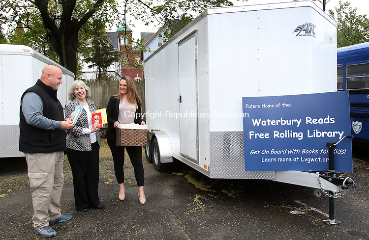 WATERBURY CT. 02 May 2016-050216SV04- From left, Chris Amatruda, PAL supervisor, Tina Agati and Stephanie Cummings of the Literacy Volunteers of Greater Waterbury check out the new trailer the volunteers will use to bring books to children in Waterbury Monday. <br /> Steven Valenti Republican-American