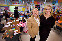 NWA Democrat-Gazette/BEN GOFF -- 02/12/15 Laurel Jackson (right), president of the Rogers Public Education Foundation Board, and Rachel Harris, vice president of the Rogers Public Education Foundation Board, pose for a photo in Robbin Prock's 1st grade classroom at Tillery Elementary in Rogers on Thursday, Feb. 12, 2015.