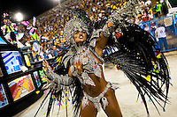 A dancer of Renascer de Jacarepagua samba school performs during the Carnival parade at the Sambadrome in Rio de Janeiro, Brazil, 20 February 2012. The Carnival in Rio de Janeiro, considered the biggest carnival in the world, is a colorful, four day celebration, taking place every year forty days before Easter. The Samba school parades, featuring thousands of dancers, imaginative costumes and elaborate floats, are held on the Sambadrome, a purpose-built stadium in downtown Rio. According to costumes, flow, theme, band music quality and performance, a single school is declared the winner of the competition.