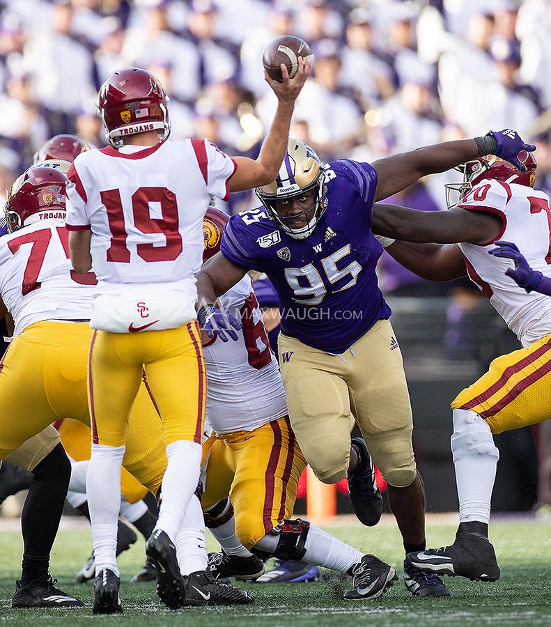 Levi Onwuzurike breaks through to pressure USC quarterback Matt Fink.