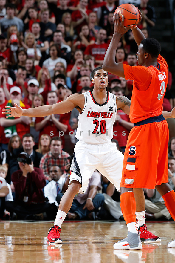 LOUISVILLE, KY - JANUARY 19: Wayne Blackshear #20 of the Louisville Cardinals defends against the Syracuse Orange during the game at KFC Yum! Center on January 19, 2013 in Louisville, Kentucky. Syracuse defeated Louisville 70-68. Wayne Blackshear