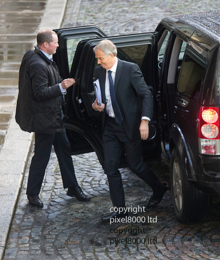 exclusive pic shows: Pic shows: Tony Blair arrives today 13.1.15<br /> to give evidence about on-the-run letters<br /> He slipped in through a side door<br /> Tony Blair will give evidence today before a parliamentary committee investigating comfort letters sent to more than 200 IRA suspects in 2007.<br /> The letters were assurances to on-the-run IRA suspects telling them they were no longer wanted by the police.<br /> The former prime minister has made attempts to avoid being grilled over the letters in what has been called a &quot;disgusting insult&rdquo; to victims of terrorists.<br /> Mr Blair initially told the Northern Ireland select committee that he was too busy as the UN envoy to the Middle East to attend and that he had nothing new to say.<br /> He is only now appearing, nine months after first being asked, because the committee issued a parliamentary summons for him to attend.<br /> <br /> <br /> <br /> <br /> <br /> Pic by Gavin Rodgers/Pixel 8000 Ltd