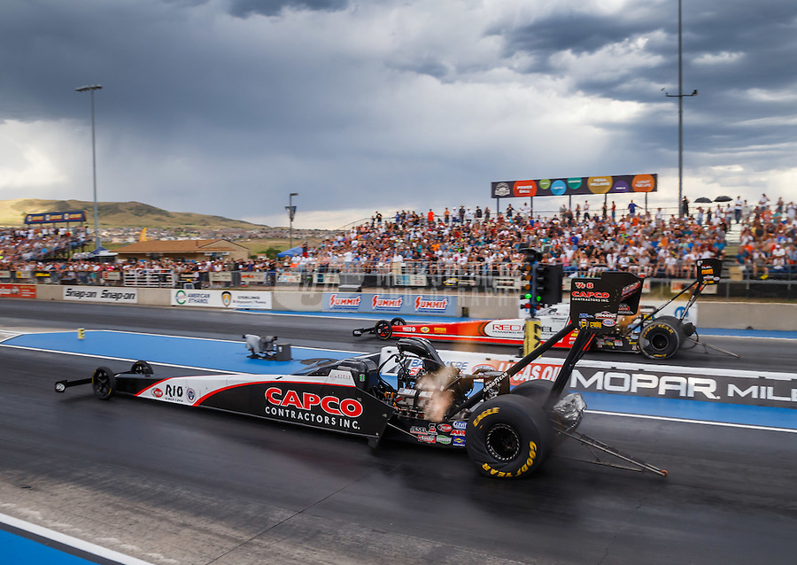 Jul 23, 2016; Morrison, CO, USA; NHRA top fuel driver Steve Torrence (near) races alongside Shawn Langdon during qualifying for the Mile High Nationals at Bandimere Speedway. Mandatory Credit: Mark J. Rebilas-USA TODAY Sports