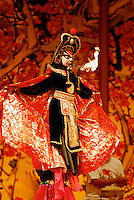 Ancient Chinese art of face-changing at Sichuan Opera, Chengdu, China. In a split second, the face mask  changes to a different color and expression. Often a series of four or five changes in as many seconds, even on stick-puppet, whose final visage spits fire.