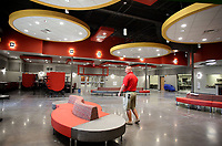 NWA Democrat-Gazette/DAVID GOTTSCHALK   Jon Purifoy, principal at Farmington High School, walks Friday, July 14, 2017, through the cafeteria at the new Farmington High School. Classes will be begin at the new school this August.