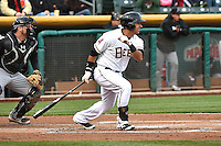Efren Navarro (16) of the Salt Lake Bees hustles down the first base line against the Sacramento River Cats at Smith's Ballpark on April 3, 2014 in Salt Lake City, Utah.  (Stephen Smith/Four Seam Images)