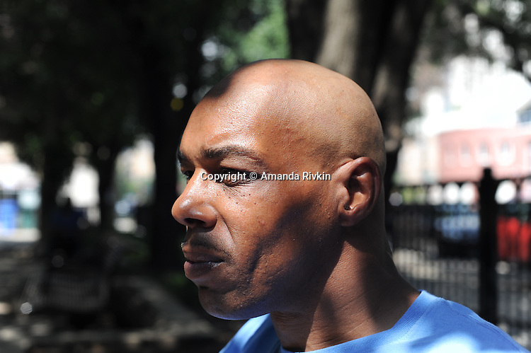 Mark Clements, a victim of Chicago police torture that occurred while Jon Burge was Commander, sits in a park in the South Loop in Chicago, Illinois on August 16, 2015.  Clements was 16 when he was arrested, tortured and accused of arson and involvement in the death of four individuals inside the building where the fire occurred and convicted at 17 before serving 26 years for a crime he did not commit; while in initial detention, police beat a false confession out of him by striking him repeatedly and squeezing his genitals.