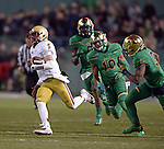 (Boston, MA, 11/21/15) Boston College quarterback Jeff Smith carries the ball past a trio of Notre Dame defenders for a fourth quarter touchdown as Notre Dame hosts Boston College at Fenway Park in Boston on Saturday, November 21, 2015. Photo by Christopher Evans