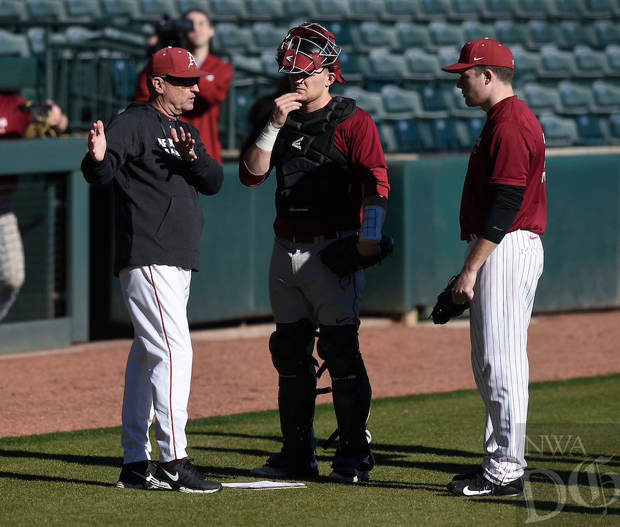 NWA Democrat-Gazette/MICHAEL WOODS @NWAMICHAELW<br /> University of Arkansas coach Dave Van Horn talks with catcher Grant Koch (33) pitcher Evan Lee (27) Friday, January 27, during Razorback baseball teams first practice for the 2017 season at Baum Stadium.