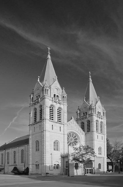 St Joseph's Catholic Church, Joliet, IL sits on North Chicago Street behiind a bright blue sky