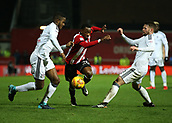 2nd December 2017, Griffen Park, Brentford, London; EFL Championship football, Brentford versus Fulham; Josh Clarke of Brentford being intercepted by Oliver Norwood of Fulham and Ryan Sessegnon of Fulham