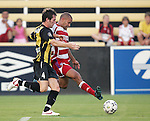 7 August 2007: FC Dallas's Abe Thompson (right) crosses the ball in front of Charleston's Tim Karalexis (4). FC Dallas of Major League Soccer defeated the Charleston Battery of the United Soccer League first division 2-1 after extra time in a quarterfinal match of the 2007 US Open Cup tournament at Blackbaud Stadium in Charleston, SC...