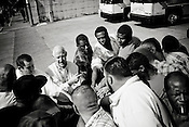 Bill Kleiber of Restorative Justice leads a prayer at the bus station near the Texas State Penitentiary in Huntsville before released offenders board buses to Dallas and Houston.