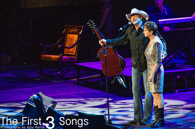 "Alan Jackson and Nancy Jones perform at the George Jones Tribute Concert ""Playin' Possum: The Final No Show"" at Bridgestone Arena in Nashville, TN"