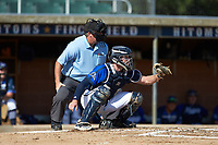 Martinsville Mustangs catcher Matthew Suggs (1) (UNC Wilmington) sets a target as home plate umpire Brian Pitts looks on during the game against the High Point-Thomasville HiToms at Finch Field on July 26, 2020 in Thomasville, NC.  The HiToms defeated the Mustangs 8-5. (Brian Westerholt/Four Seam Images)