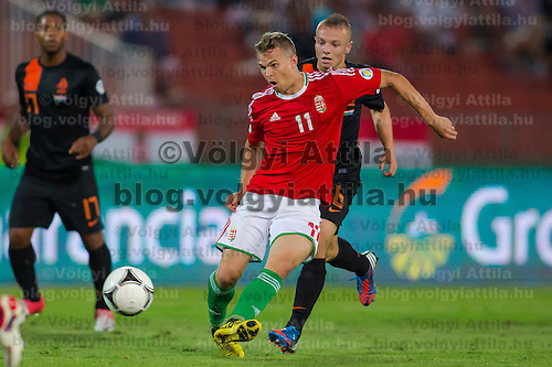 Hungary's Vladimir Koman (front) and Netherlands' Jordy Clasie (back) fight for the ball during a World Cup 2014 qualifying soccer match Hungary playing against Netherlands in Budapest, Hungary on September 11, 2012. ATTILA VOLGYI