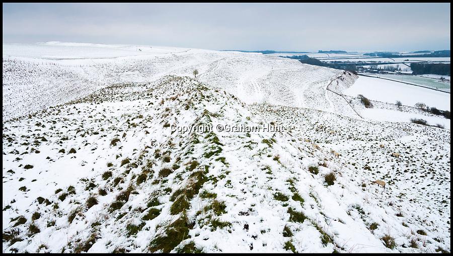 BNPS.co.uk (01202 558833)<br /> Pic: Graham Hunt/BNPS<br /> <br /> A blanket of snow covers the ancient hillfort of Maiden Castle near Dorchester in Dorset.