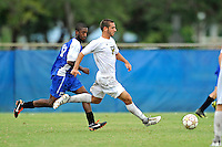 2 October 2011:  FIU midfielder/forward Nicholas Chase (8) moves the ball upfield while being pursued by Kentucky midfielder Josh McCrary (17) in overtime as the FIU Golden Panthers defeated the University of Kentucky Wildcats, 1-0 in overtime, at University Park Stadium in Miami, Florida.