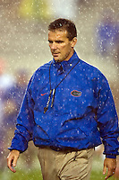 November 29, 2008:   Florida head coach Urban Meyer walking in the pre-game rain prior to  first half non-conference game action between the University of Florida Gators  and the Florida State Seminoles at Doak Campbell Stadium in Tallahassee, Florida.