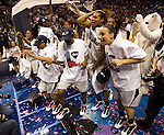 040709TVWOMENFINALFOUR11.UConn players celebrate after defeating Louisville 76-54 at the NCAA Women's Final Four at the Scottrade Center in St. Louis, MO on Tuesday April 7, 2009..MCT/TIM VIZER