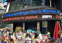 A news ticker in Times Square in New York on Tuesday, September 1, 2015 reports that the Dow Jones dropped 470 points, its third biggest drop of the year. The rout was started by weak Chinese economic data.  (© Richard B. Levine)