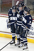 Dan Correale (UNH - 13), Grayson Downing (UNH - 28), Austin Block (UNH - 3) - The Boston College Eagles and University of New Hampshire Wildcats tied 4-4 on Sunday, February 17, 2013, at Kelley Rink in Conte Forum in Chestnut Hill, Massachusetts.