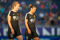 Orlando, Florida - Sunday, May 14, 2016: Western New York Flash midfielder Samantha Mewis (5) and defender Abby Erceg (6) during warm-ups of a National Women's Soccer League match between Orlando Pride and New York Flash at Camping World Stadium.