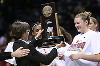 31 March 2008: Tara VanDerveer holds the regional championship trophy as Jayne Appel looks on after Stanford's 98-87 win over the University of Maryland in the elite eight game of the NCAA Division 1 Women's Basketball Championship in Spokane, WA.